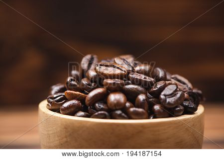 Coffee Beans. Coffee Cup Full Of Coffee Beans.