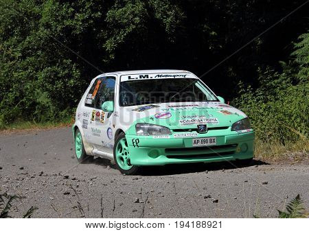 La Spezia Italia - July 2 2017 -Rally Gulf of Poets: The Peugeot 106 rally Bertagna-Ulivi crew during the first special race race test.