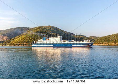 Grimaldi Group eurocargo ship cruising at sunset in Corfu, Greece