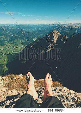 The Crossed Legs Take A  Rest On Tiring Mountain Trail. Sweaty Male Legs In Dark Trekking Trousers R