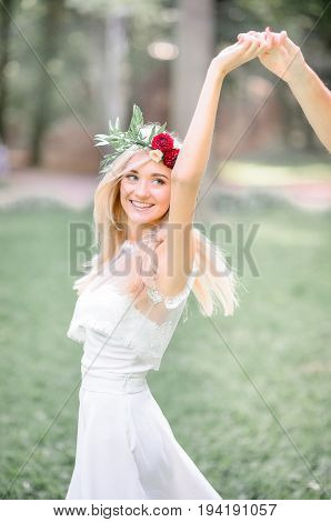 Blonde Bride's Hair Fly While She Whirls Around Groom's Hand