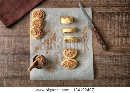 Raw cinnamon rolls on kitchen table