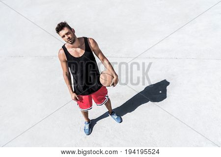 High Angle View Of Athletic Basketball Player With Ball Standing On Court
