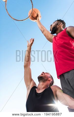 Low Angle View Of Multiethnic Basketball Players During Basketball Game