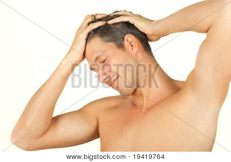 Friendly smiling man having hands in hair after haircut expressing positive