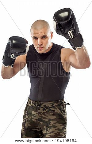A young sports guy in a black T-shirt and khaki pants. Boxer fighter on isolated background