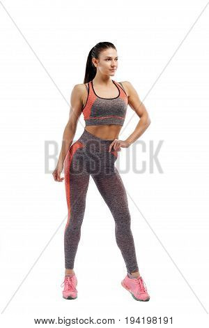 Positions of fitness bikini. Beautiful young sportive woman fitness fit-fitting clothes posing on white isolated background. Fitness model