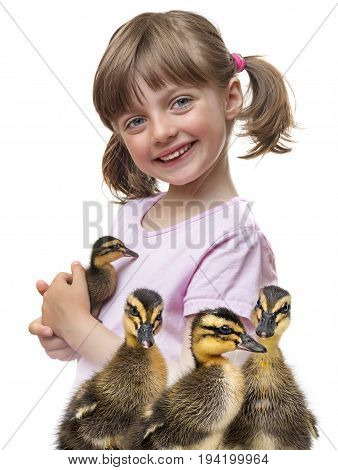a little girl holding a duckling close up