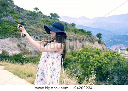 Woman Traveler Makes A Self In The Background Beautiful Natural View Mountain On The Island Of Crete