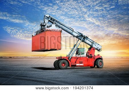 Logistics import export background of container handling forklifts at the dock