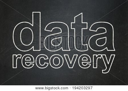 Information concept: text Data Recovery on Black chalkboard background