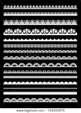 Set of white lace borders isolated on black background