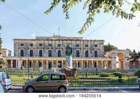 Statue of Sir Frederick Adam in front of the Palace and museum of asian art . Corfu island streets. Greece.