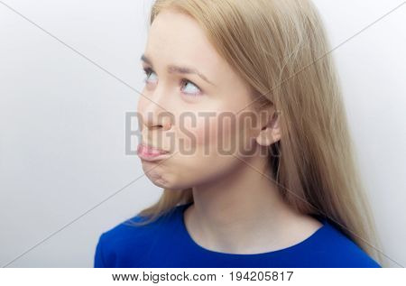 Woman Sulking With Pursed Lips