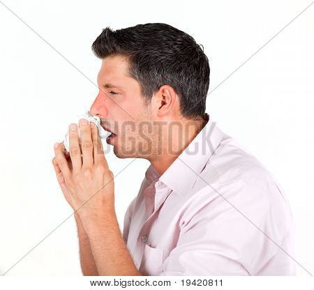 Cold having masculine macho sneezing with red nose into paper tissue