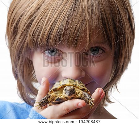 happy little girl with her pet - tortoise