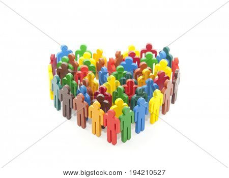 Group of colorful painted people figures in the shape of a heart