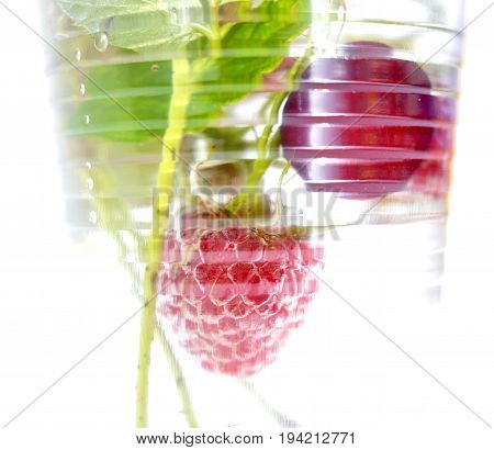 Ripe Organic Raspberry And Sour Cherry In A Disposableplastic Cup