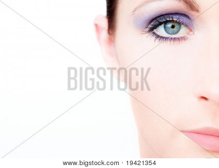Beautiful open painted colorful female eye closeup