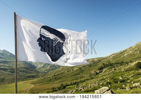 corsican flag on a sunny day with landscape