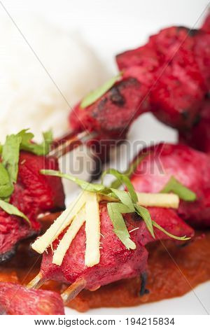 close up of indian chicken tikka dish with rice
