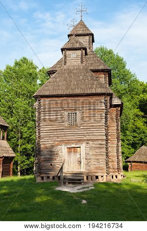 Ancient wooden church (XVIII century) from the Northern Ukraine in the open-air Museum of Folk Architecture near Kyiv.