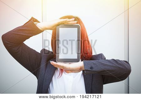Business Concept Of Success And Negotiation. A Woman Boss, In A Suit And Glasses, Shows A Tablet Ins