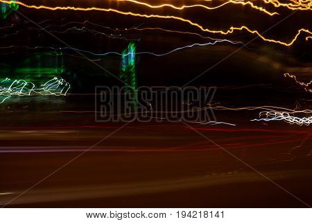 Moving along the night road. Night traffic. City life. Blurred lights for abstract color background.