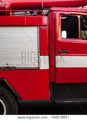 Red fire engine. Side view. Close up.