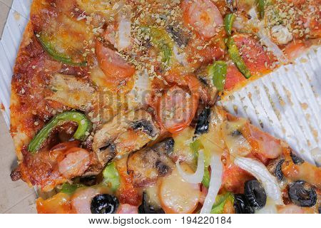 Italian Pizza With Ham, Pepper And Olives