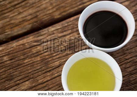 Close-up of olive oil and balsamic vinegar in bowl on table