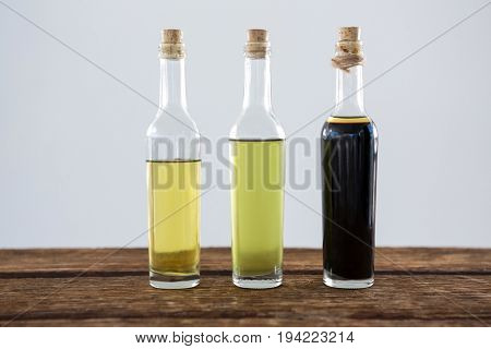Close-up of olive oil and balsamic vinegar in bottle on table