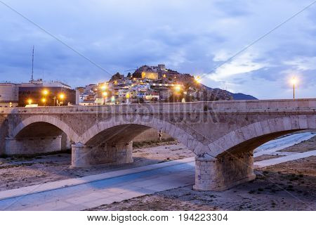 Historic stone bridge over the Guadalentin river in Lorca illuminated at night. Province of Murcia southern Spain