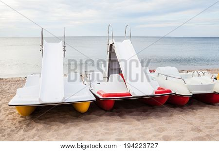Catamarans on the beach at the seaside.