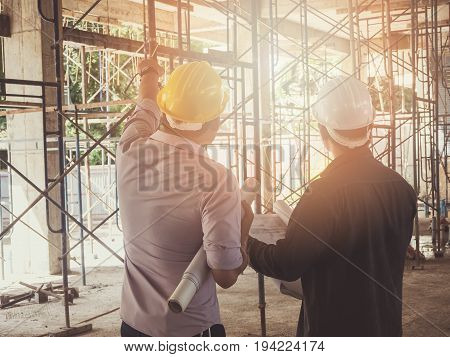 Engineer Discussing With Foreman About Project In Building Construction Site