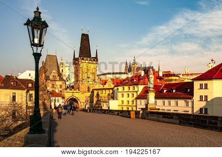 Charles Bridge with Lesser Town Bridge Tower and Prague Castle on background. Sunny morning in Prague, Czech Republic.