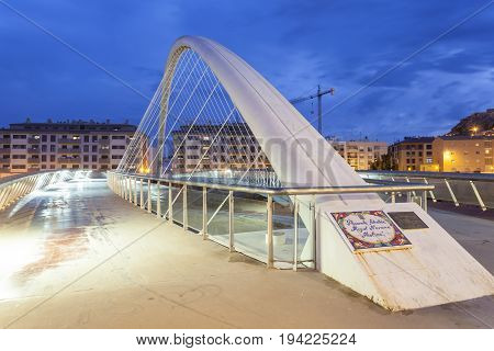 Lorca Spain - May 29 2017: Modern bridge over the Guadalentin river in Lorca illuminated at night. Province of Murcia southern Spain