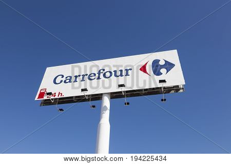 Huelva Spain - June 3 2017: Logo of the french supermarket chain Carrefour in the city of Huelva Andalusia Spain