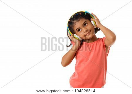Music and technology concept.Child with headphones on white background.Copyspace