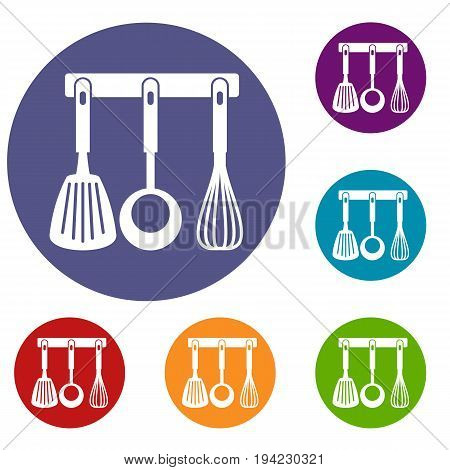 Spatula, ladle and whisk, kitchen tools on a hanger icons set in flat circle reb, blue and green color for web