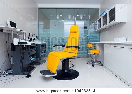 Stylish bright orange armchair in the dentist's office