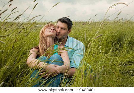 Park couple in natural park embraced together