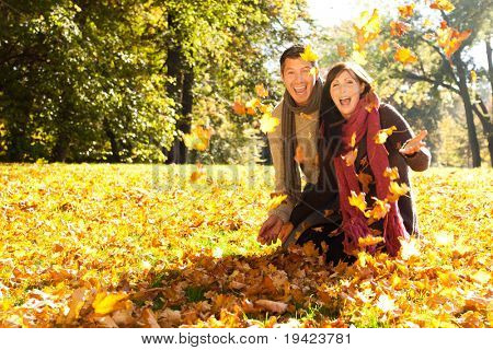 Portrait of couple enjoying golden autumn fall season