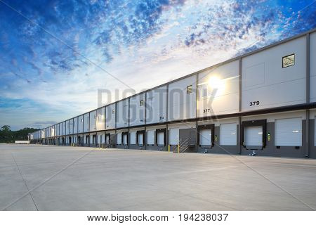 Generic White Loading Docks on Industrial Building Exterior
