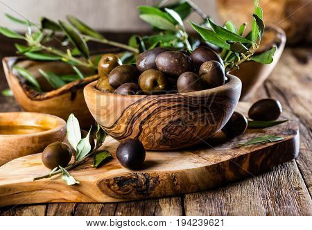 Olives And Olive Oil In Olive Wooden Bowls, Olive Tree Branch