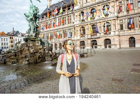 Young woman tourist standing on the Great Market square in Antwerpen, Belgium
