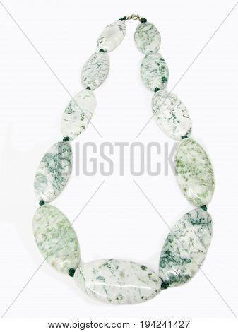 jewelry white and green beads isolated on white background