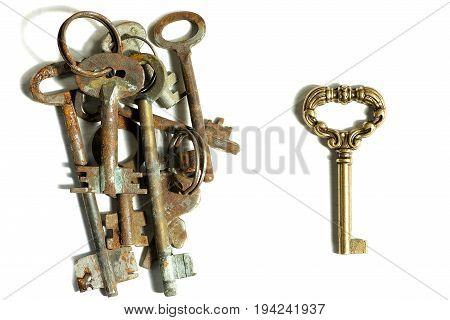 Different keys pile of rusty old and one new shiny on white background contrast contradistinction symbol