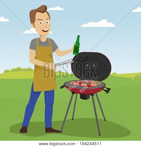 Handsome young man cooking barbecue grill outdoors holding a bottle and tongs