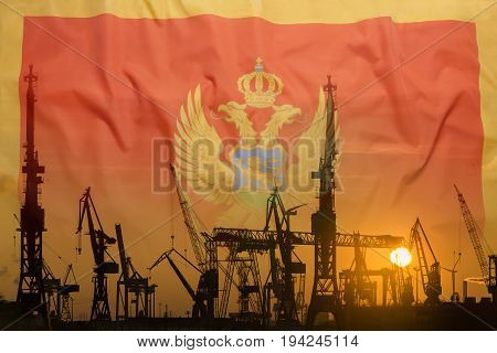 Industrial Concept With Montenegro Flag At Sunset